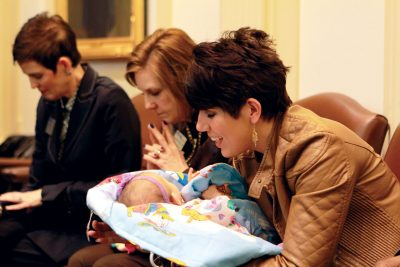 Former keynote speaker Melissa Ohden with her infant.