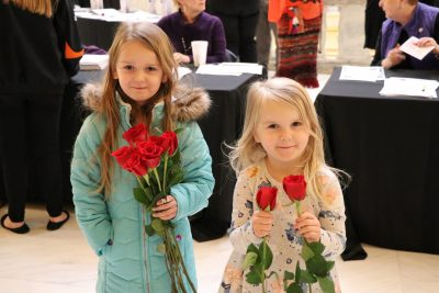 Rose Day participants with their roses